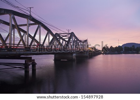 Evening view of the Old bridge in Kampot, Cambodia - stock photo