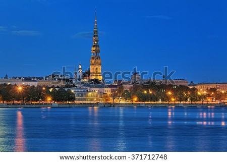 Evening view of the St. Peter's Church from the shore of Daugava in Riga, Latvia - stock photo