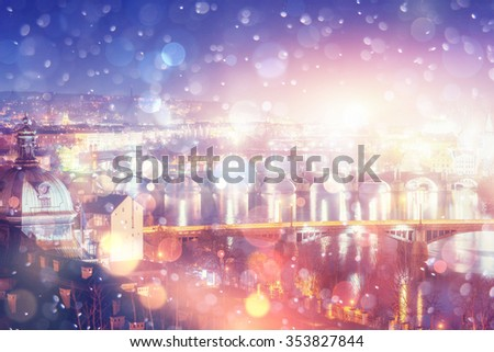 Evening View of The Vltava River and Bridges in Prague , Czech republic,  bokeh background with snowflakes - stock photo