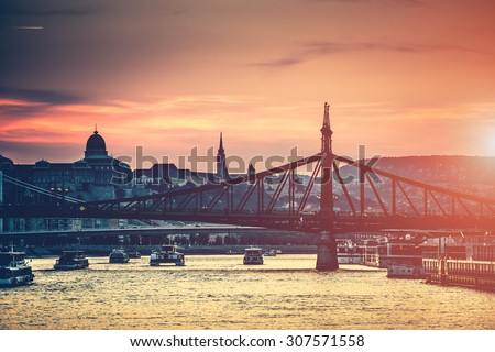 evening view on Budapest from river to the bridge and architecture - stock photo