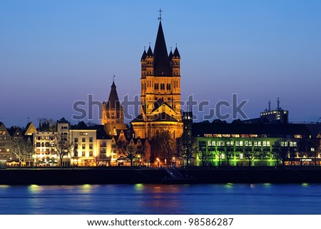 Evening view on Great St. Martin Church and Tower of City Hall in Cologne, Germany