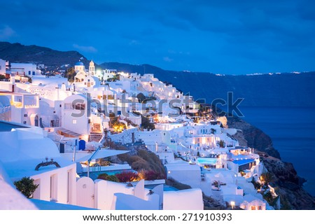 Evening view on Oia city, Santorini with typical greek white and illuminated buildings in the night