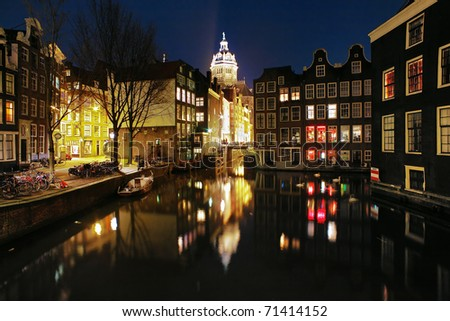 Evening view on the channels of Amsterdam and St. Nicolas Church (St. Nicolaaskerk), Netherlands - stock photo