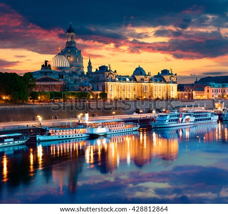 Evennig view of Academy of Fine Arts and Baroque church Frauenkirche cathedral. Colorful sunset on Elbe river in Dresden,  Saxony, Germany, Europe. Artistic style post processed photo.