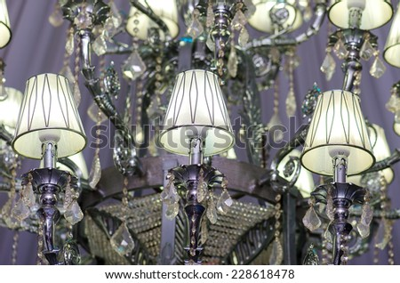 Event ballroom chandelier close-up - stock photo