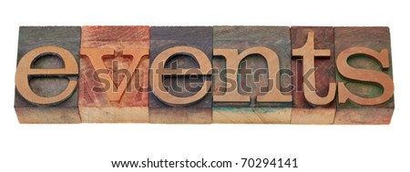 events word in vintage wooden letterpress printing blocks, stained by color inks, isolated on white