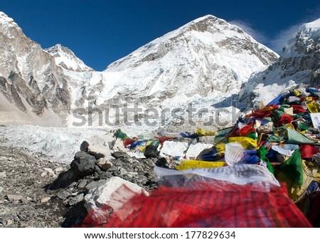 Everest base camp, khumbu glacier and prayer flags - Nepal - stock photo