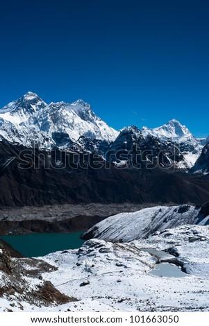 Everest, Nuptse, Lhotse and Makalu peaks. Gokyo lake and village. Gokyo lake and village - stock photo