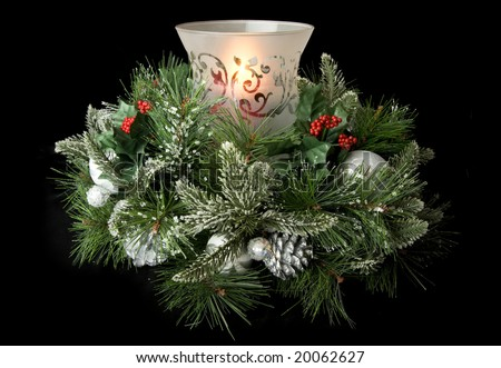 Evergreen centerpiece candle with greenery - stock photo