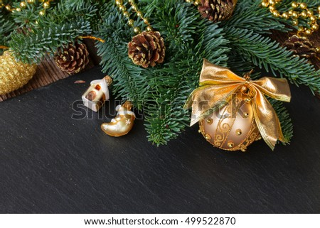 evergreen tree with golden balls on black background