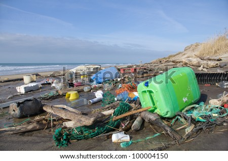 Every day, waste accumulates on the beach of Atlantic west coast, they arrive from Spain with ocean currents effect. - stock photo