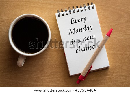 Every Monday is a new chance - motivational handwriting on notebook with a cup of coffee