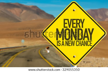 Every Monday Is a New Chance sign on desert road - stock photo