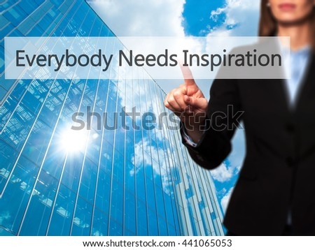 Everybody Needs Inspiration - Businesswoman hand pressing button on touch screen interface. Business, technology, internet concept. Stock Photo