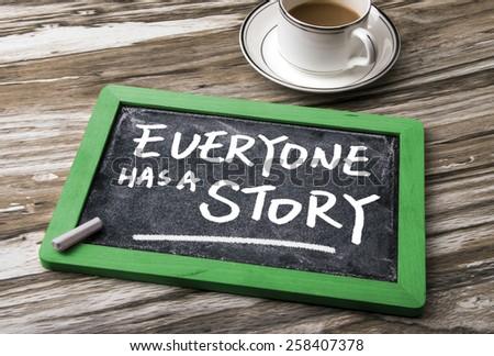everyone has a story on blackboard - stock photo