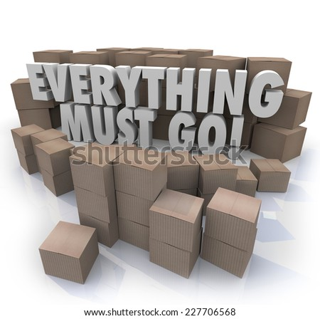 Everything Must Go words in 3d letters surrounded by cardboard boxes in a store warehouse to illustrate overstock inventory for a sale or clearnace event - stock photo