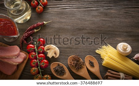 everything on wood table for the cooking of acute Italian sauce (tomato garlic spices olive oil) flat lay