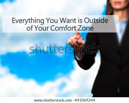 Everything You Want is Outside of Your Comfort Zone - Businesswoman hand pressing button on touch screen interface. Business, technology, internet concept. Stock Photo
