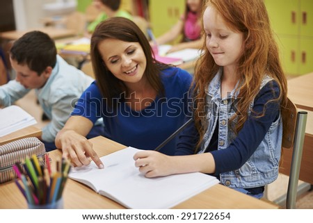 Everytime our teacher is very helpful - stock photo