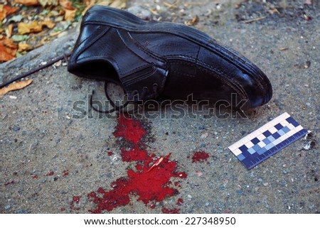 Evidence and blood at crime scene  - stock photo