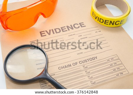 evidence bag with forensic tool for detective and crime scene investigation - stock photo