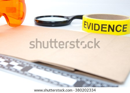 evidence tape and forensic tool for crime scene investigation - stock photo