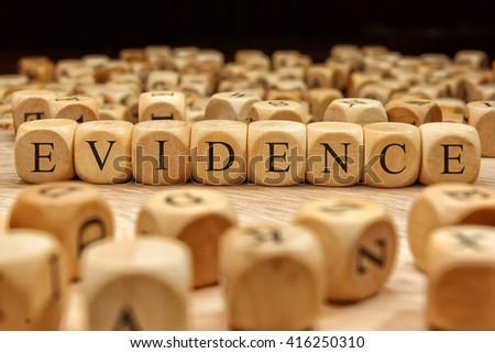 Evidence word written on wood block - stock photo