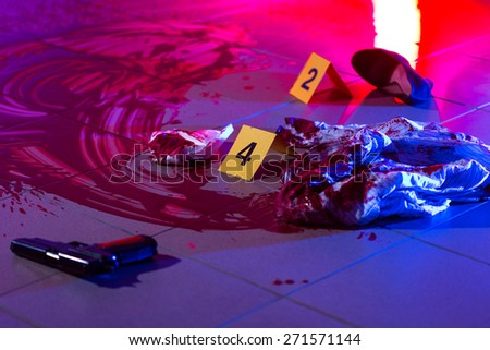 Evidences and blood at the murder scene - stock photo