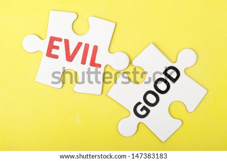 Evil and good words on two pieces of puzzle
