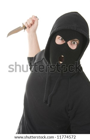 evil criminal wearing balaclava with a knife