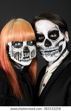 Evil day of the dead undead couple posing