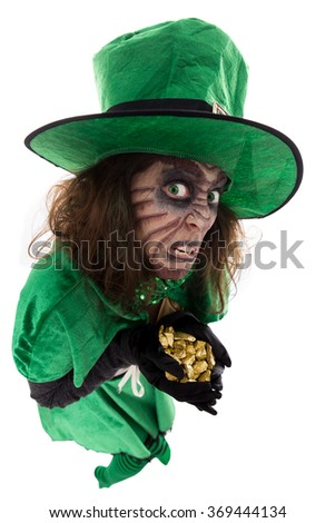 evil leprechaun girl holding a treasure, concept Legends and Ireland, isolated on white