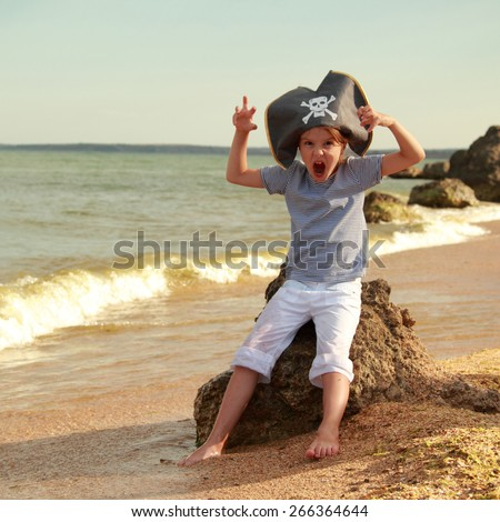 Evil little girl pirates running on the beach in summer sunny day - stock photo