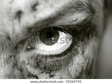 evil looking eye, smudged make up on the face - stock photo