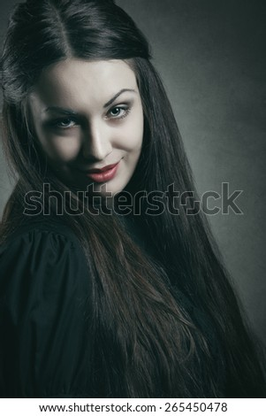 Evil smile on beautiful vampire face . Halloween and horror - stock photo