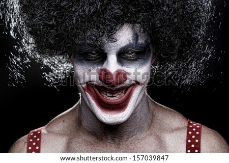 Evil Spooky Clown Portrait on Black Background