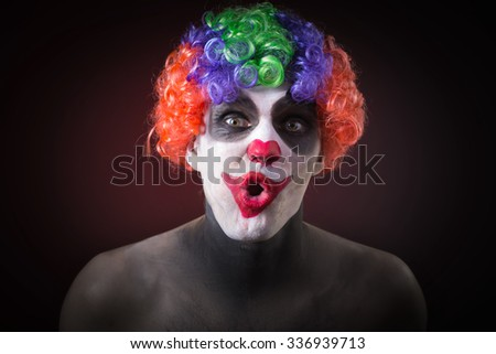 Evil Spooky Clown Portrait on dark background. expressive man
