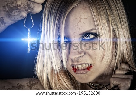 evil vampire and the bright light of the cross - stock photo
