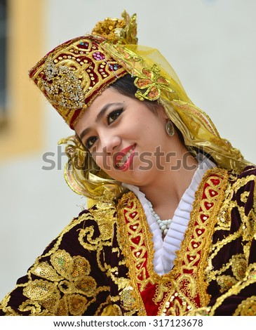 EVOLENE, SWITZERLAND - AUGUST 13: Beautiful Uzbekistan dancing girl from Issar in the CIME mountain culture Festival: August 13, 2015 in Evolene, Switzerland