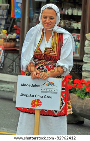 EVOLENE, SWITZERLAND - AUGUST 15:  Macedonian dancer with sign at the International Festival of Folklore and Dance from the mountains (CIME) : August 15, 2011 in Evolene Switzerland