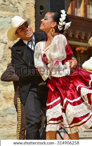 EVOLENE, SWITZERLAND - AUGUST 11: Mexican dancing couple from Guadelupe Omexochitl in the CIME mountain culture Festival: August 11, 2015 in Evolene, Switzerland - stock photo