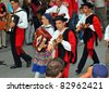 EVOLENE, SWITZERLAND - AUGUST 15: Portuguese musicians at the International Festival of Folklore and Dance from the mountains (CIME) : August 15, 2011 in Evolene Switzerland - stock photo