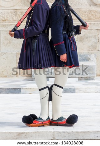 Evzones (presidential ceremonial guards) guarding the Tomb of the Unknown Soldier at the Hellenic Parliament - stock photo