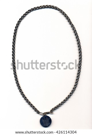 ewellery made of silver chain with a medallion with a trident - stock photo