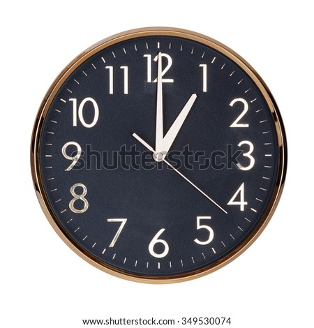 Exactly one hour on the round clock face - stock photo