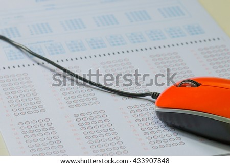 exam, multiple choice test, test score sheet for education with red computer mouse - stock photo