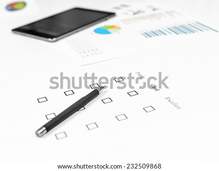 Examination business list on the office table - stock photo
