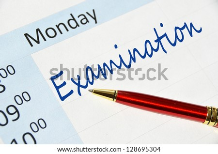 Examination note in the agenda - stock photo