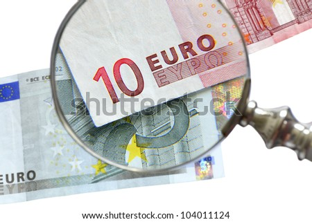examination of euro banknote with magnifying glass - stock photo