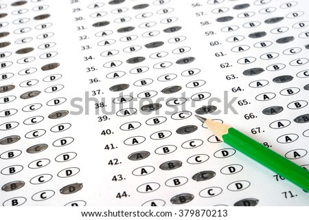 Examination test sheet with pencil. Education concept
